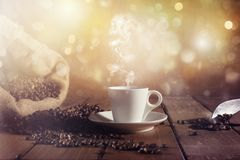 Background of cup of coffee beans. With jute bag and bailer royalty free stock photos