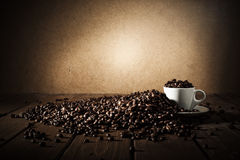 Background of cup of coffee beans royalty free stock photos
