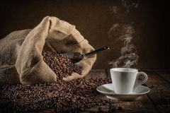 Background of cup of coffee beans stock photos