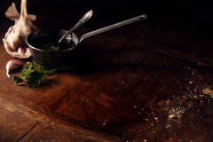 Background with cup of olive oil and garlic Royalty Free Stock Image