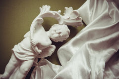 Background with cupid and white silk Royalty Free Stock Photos