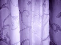 A background with curvy lines and violet tint. royalty free stock image