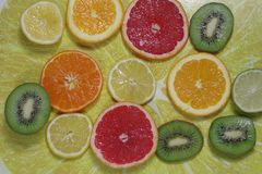 Cut citrus fruits. Background with cut citrus fruits Royalty Free Stock Photography
