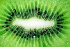Background from cut fruit of kiwi Royalty Free Stock Image