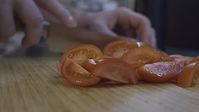 On the background of the cut tomatoes are sliced tomatoes stock footage