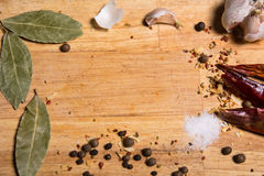 Background cutting board and seasonings for cooking Royalty Free Stock Image