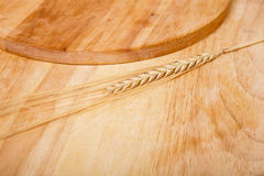 Background of cutting boards spikelet of wheat Royalty Free Stock Photos