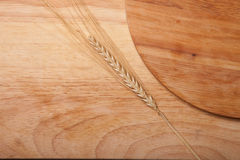 Background of cutting boards spikelet of wheat Stock Photography