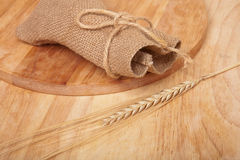 Background of cutting boards and spikelet of wheat and sac Royalty Free Stock Photo