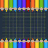 Background of the cutting mat and border of colored pencils. Place for your text. Royalty Free Stock Photo