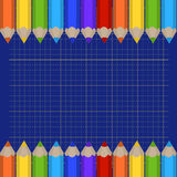 Background of the cutting mat and border of colored pencils. Place for your text. Stock Photography