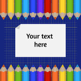 Background of the cutting mat and border of colored pencils. Place for your text. Stock Photos