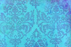 Background damask weaving pattern. Background created in shades of blue by a damask weaving pattern reminiscent of small flowers and foliage Stock Photo
