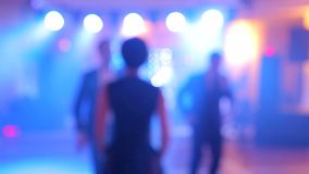 Background of the dance is blurred people dancing in a nightclub. Background of the dance is blurred people dancing in a nightclub stock video