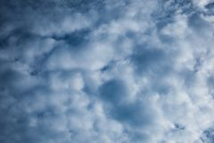 Background of dark blue clouds before a thunder-storm stock image