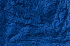 Dark blue wrinkled paper royalty free stock photos