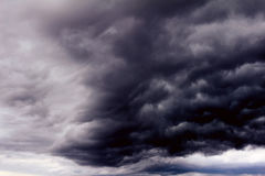 Background of dark clouds. Before a thunder-storm Stock Images