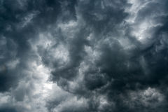 Background of dark clouds before a thunder-storm ,sunlight through very dark clouds background ,White Hole in the Whirlwind of dar Royalty Free Stock Images