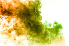 Background of dark green, yellow, orange and red wavy smoke on a white isolated ground. Abstract pattern from vape stock image