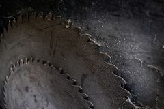 Background of dark metal saw blades of old circular saw with cob. Webs. Vintage stock images