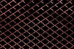 Background of dark red metal net texture Royalty Free Stock Photography