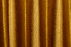 The background dark shiny brown with gold fabric. The background dark shiny brown with gold fabric Stock Photography