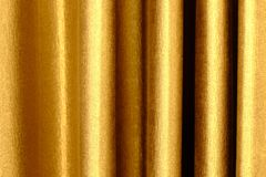 The background dark shiny brown with gold fabric. The background dark shiny brown with gold fabric Royalty Free Stock Image