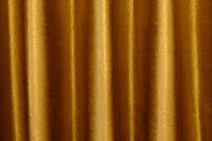 The background dark shiny brown with gold fabric. The background dark shiny brown with gold fabric Stock Images