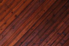 Background of dark wood. Planks are located on the diagonal Royalty Free Stock Images