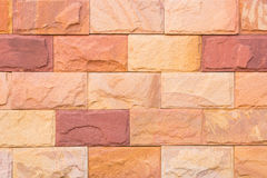 Background of decorate sand stone wall Stock Images