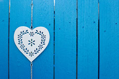 Background - Decorative metal heart hanging on fence Royalty Free Stock Photo