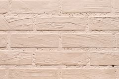 Background of decorative plaster beige in the form of bricks in the interior royalty free stock photos