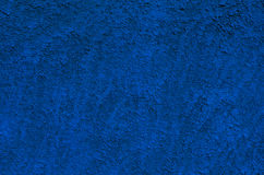 Background of a deep blue stucco coated and painted exterior, rough cast of cement and concrete wall Royalty Free Stock Photography