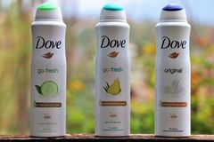 Three different spray air fresheners of the well-known brand `Dove`. stock photos