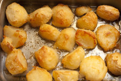 Background of delicious golden roast potatoes Royalty Free Stock Images