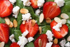 Background delicious salad of strawberries, spinach, almonds Stock Photos