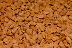 A background of delicious salty peanuts, a texture of peanuts.  Stock Images