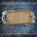 Background denim texture with cardboard label Stock Photography
