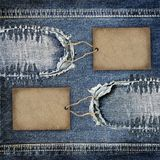 Background denim texture with cardboard label Royalty Free Stock Photos