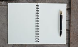 Design concept - Top view of hardcover kraft notebook and ballpoint pen Royalty Free Stock Photo