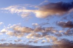 Background for the designer. Beautiful sunset blue sky with clouds. royalty free stock images