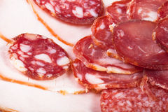 The background - detail of sliced salami Stock Images