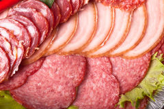 The background - detail of sliced salami Stock Photography