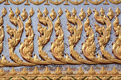 Background: Detailed gold sculpture on the wall Stock Photography