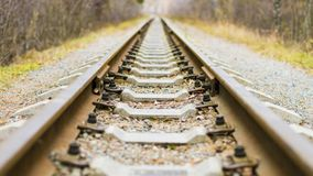 Background of diagonal railroad at dusk with copy space. Rails, sleepers, fastenings and crushed stone close up. Railway. Traveling royalty free stock photos