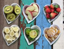 Background of diet food in heart shaped bowls set on vintage woo Royalty Free Stock Photos