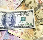 Background different banknotes of us dollars and Ukrainian hryvnia royalty free stock photo