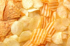 Background from different chips close-up. Snacks. unhealthy food. royalty free stock photo