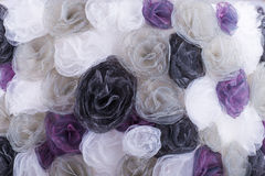 Background of different colors blossoms from cloth Stock Photos