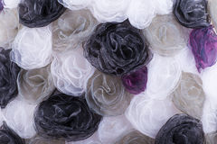 Background of different colors of cloth flowers Stock Image